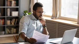 Man thinking of objections to group captive insurance image